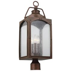 The Randhurst Outdoor Post Mount is a modern interpretation of an antique gas lantern, made of StoneStrong composite material that can withstand the harshest outdoor elements and finished in Copper Oxide. Handcrafted stepped details, grommets and open vents on the crown add charm to this period-inspired collection. Three 60 watt max 120 volt candelabra base bulbs are required, but not included. 8.9 inch width x 23.6 inch height. Compatible with Feiss outdoor posts; sold separately. UL/ETL… Outdoor Post Lights, Outdoor Wall Lantern, Hanging Lanterns, Outdoor Lighting, Yard Lighting, Driveway Lighting, Pathway Lighting, House Lighting, Lanterns