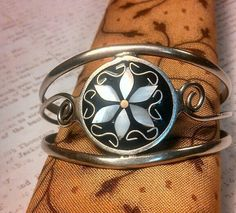 Silver cuff bracelet with flower and scrolls. Stamped. Mexico? 925.