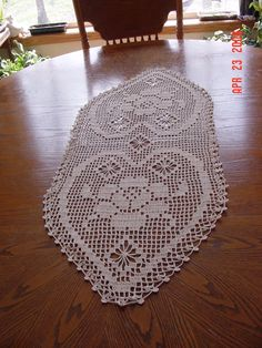 "The pattern for this table runner can be found in ""Romantic Crochet"" book by Better Homes & Gardens."