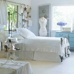 I love this idea for our guest room/sewing room. I really like the white. :)    Guest Room #2 - and could also double as a sewing craft room.  All white is rejuvenating. This space makes me calm.  I love the dress form and the blue bureau is gorgeous! The antique bed and decorations create a cozy, cottage like atmosphere.