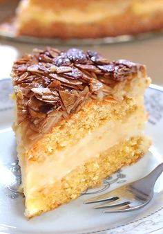 Bee Sting Cake - Crunchy, honey-flavored almond topping, creamy filling, and two delicious yeast cake layers make this traditional German dessert absolutely wunderbar! German Bee Sting Cake, German Cake, Sweet Recipes, Cake Recipes, Dessert Recipes, Bienenstich Cake, Traditional German Desserts, Deutsche Desserts, Cake Ingredients