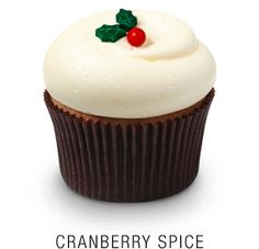 Georgetown Cupcake | DC Cupcakes | Menu///Georgetown Cupcake's version of the traditional English Christmas spice cake, baked with fresh cranberries and orange zest and topped with classic vanilla cream cheese frosting and a fondant holly leaf