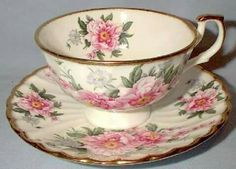 Tea cup/saucertrimmed with gold and decorated with red roses, love roses!