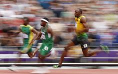 Jamaica's Usain Bolt competes in a men's 200-meter heat during the athletics in the Olympic Stadium