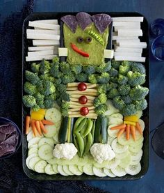 Celebrate the Halloween season with these fun and spooky snacks and sweets, like a guacamole and vegetable platter designed to look like Frankenstein!