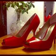 Nine West 7.5 Hot Red peep-toe pump Sassy candle apple red synthetic 4 inch squared peep toe pump. Gently worn indoors. Was a Nine West asst manager and will have lots of authentic Nine West products for sale Nine West Shoes