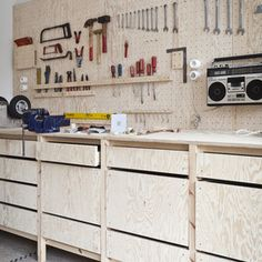 {plywood organization} with pegboard and drawers.