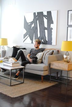 We're taking a tour of west elm Home Stylist, Tyler Meyerkorth's Los Angeles home, where he mixed texture, shades of grey and pops of yellow to create a comfortable yet modern apartment.