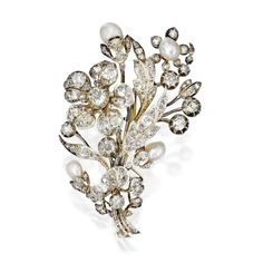 SILVER, GOLD, DIAMOND AND PEARL BROOCH. Designed as a floral spray set with four pearls measuring approximately 10.9 by 6.6 by 6.1 mm to 9.8 by 6.5 by 4.9 mm, accented by numerous old mine, old European and rose-cut diamonds weighing approximately 10.85 carats; brooch fitting detachable, two small diamonds missing, circa 1870.