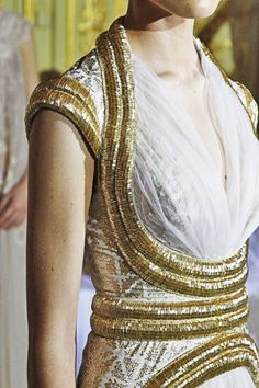 gold and white gown  by Rami Al Ali  Haute Couture Spring/Summer 2012  from fashionfreak56.tumblr.com