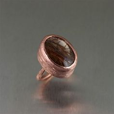 Seek gorgeous respite in the relaxing sparkle of this stunning #copper #ring featuring a 17 carat #Bronze Rutilated #Quartz gemstone set in a handcrafted #copper bark texture. #handmadejewelry