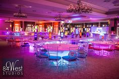LOVE the under table lighting for a fun event. Neon blue lights with spandex table cloth linens. Very sleek and chic.  Bella's Bat Mitzvah Decor, Photography, and Entertainment by 84 West Events, www.SouthFloridaMitzvahs.com (954)236-9000