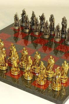 Fantasy Pewter Chess Set with Red and Grey Gloss Chessboard  $584.96   Buy at ChessSetsOnline.com