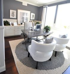 I LOVE the sleek gray desk with the bright white chairs and accents in this office!!