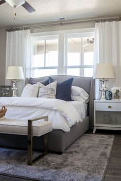 Alice Lane Home Collection | Daybreak Lake Loft | Gray upholstered bed in Master Bedroom, white bedding and neutral decor | Lindsay Salazar Photography: