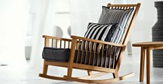 InOut Rocking Chair by Gervasoni. This chair is made from solid American Walnut and is generously sized for getting cozy in.
