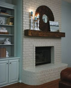 LOVE the dark wood mantle For Lisa: Paintthe brick fireplace white and the mantel a dark color so it'll pop.Also need to paint the gold on the cover, maybe black like thispicture