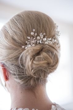 Brides wedding hair with a pretty hair piece.