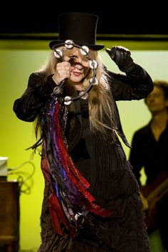 stevie nicks - I'd love to have one of her many ribbon/scarf adorned tambourines!!