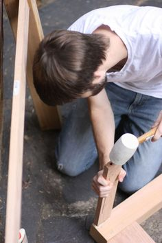 Average Joe learns to build a desk by experimenting, consulting with friends.