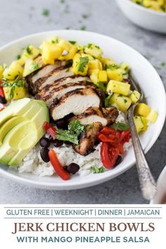 Get ready to be taken to Jamaica with these Jerk Chicken Bowls with Mango Pineapple Salsa served over coconut rice. What really makes this Jerk Chicken Bowl pop is all the other tropical flavors mixed in. The coconut rice and beans along with the Mango Pineapple Salsa! The combo of the sweet, salty, spicy and creamy will have your taste buds going crazy! It's an easy weeknight meal your family will love! #jerkchicken #grilledchicken #chickenbowls