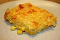 Corn Casserole: 1 (15 oz) can whole kernel corn, drained 1 (15 oz) can cream-style corn 1 package Jiffy corn muffin mix (8 oz.) 1 cup sour cream 1/2 cup butter, melted 1 cup shredded cheese Preheat oven to 350 degrees. mix all ingredients, minus the cheese, together and pour into a greased baking dish. Bake for 45 minutes or until set in the middle and golden brown, sprinkle with cheese and put it back in the oven to let the cheese melt.