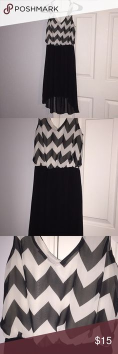"Cute Rue 21 high-low chevron dress 🖤👗 Size medium Rue 21 high-low dress.Off white chevron pattern on top. I'm 5'4"" the dress is high-low front of the dress stops right above my knees and the back of the dress goes half way down my calves. Worn and washed once. Smoke free home. Rue21 Dresses High Low"