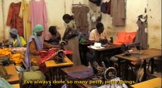 """A scene from my documentary """"Africa's Daughters"""" of Martha making dozens of school uniforms to help pay for her daughter Ruth's education."""