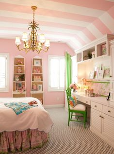 classic kids bedroom Solids and stripes - This pretty-in-pink bedroom is saturated with light pink, set off by the thick white stripes on the ceiling. The striped paper provides a visual break from all that pink, while enhancing rather than disrupting the look and feel of the room. The choice of thick stripes rather than thin stripes adds interest and a visual rest without overdoing the effect