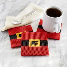 """Sure Santa likes cookies but we're pretty sure he LOVES a good cup of coffee. How cute are these #DIY Perler Santa Belt coasters?!"""