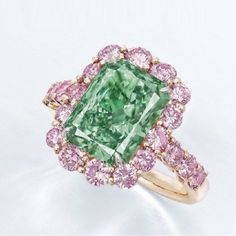 This gorgeous piece of jewelry was just sold at Christie's Hong Kong Magnificent Jewels sale for more than $16.8 million, which is more than $3.3 million per carat! Its unique rectangular-cut VS2 fancy vivid green diamond named Aurora Green is set in a gold ring and surrounded by pink diamonds for added contrast and magnificence. Simply Splendid! Source: Forbes. More on diamonds: www.diamonds.pro