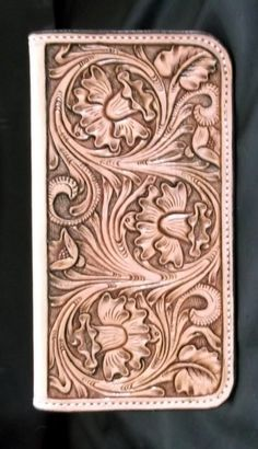 Custom leather hand tooled floral checkbook cover. love the pattern on this, love it