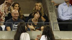 Christine Taylor and Kristen Wiig enjoys the night session on day 11 of the 2012 US Open - Philip Hall/USTA