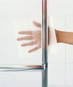 To Remove obstinate soap buildup from glass shower doors by sprinkling a few drops of water onto a used fabric-softener sheet and scrubbing.