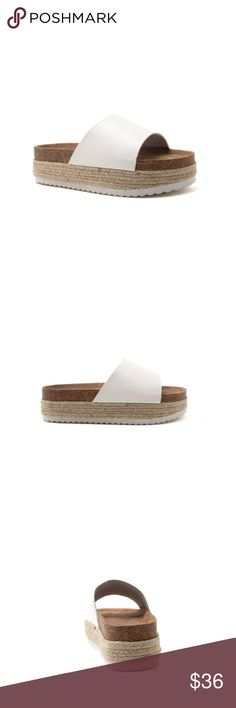 "Ladies flatform slides in white color. NIB KEEP IT FRESH THIS SPRING WITH THESE ADORABLE FLATFORM ESPADRILLE SANDALS! FEATURES A WIDE FAUX LEATHER BAND AND A FLATFORM SOLE WITH A WRAPPED ESPADRILLE PLATFORM. BRAND NEW IN BOX. Black COLOR AVAILABLE IN DIFFERENT LISTING  MATERIAL: MADE MADE, LEATHERETTE  SOLE: SYNTHETIC.  MEASUREMENT: HEEL HEIGHT 2"" (APPROX.)  FITTING: TRUE TO SIZE SHOEROOM21 boutique  Shoes Flats & Loafers"