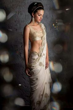 Just love this white and gold saree! Saree blouse design. statement earrings.
