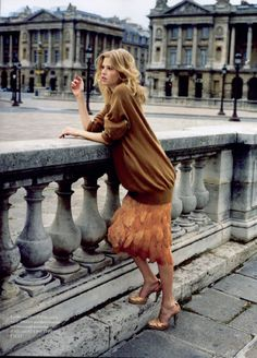 long sweater + feathered skirt