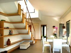 cozy white leather dining chairs and square table design feat unusual under stairs shelving storage idea
