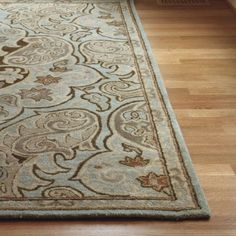 Wool rug with tones of chocolate, mushroom, oatmeal, and blue grey.  would look nice on the light carpet in Master.