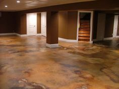 Acid stained basement flooring. I love this look!
