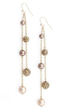 Free shipping and returns on St. John Collection Swarovski Crystal & Glass Pearl Pavé Drop Earrings at Nordstrom.com. Two delicate chains drop from French wires suspending luminous pearly globes and twinkling crystal-encrusted spheres for dangling earrings with whimsical kinetic appeal.