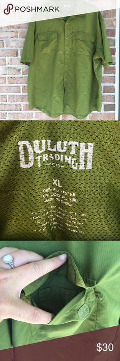 Duluth Trading Co. Action Shirt Green Size XLarge Action Shirt Tames Swampy Heat, Blazing Rays The best shirt for humid heat and abrasive situations – now even cooler with more carrying capacity 3.4-oz. 65% polyester/35% CoolPlus polyester ripstop wicks moisture, dries in a flash. UPF 50 sunburn protection. Mesh-lined cape back catches the slightest breeze. Reach freely thanks to F.O.M.™ (Freedom of Movement) Armpit Gussets. 2 spill-proof flapped pockets with hidden cellphone sleeve in…