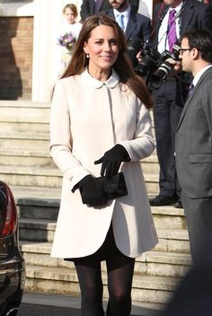 Kate Middleton Shines in White For an Official Visit With Prince William: Kate Middleton donned a white jacket.: Kate Middleton wore a collared white jacket with black gloves.