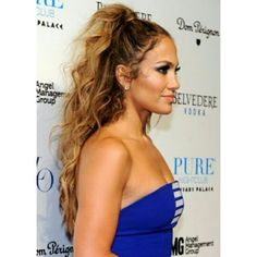 High half up ponytail and tousled waves