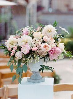 pastel floral arrangement - photo by Shane and Lauren Photography http://ruffledblog.com/romantic-temecula-wedding-with-vintage-books #flowers #weddingflowers