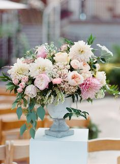 pastel floral arrangement - photo by Shane and Lauren Photography http://ruffledblog.com/romantic-temecula-wedding-with-vintage-books #flowers #weddingflowers