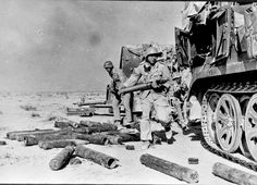 Crew members if a Famo SdKfz 8 unloading amo fast during the operation of an 88mm gun during the Battle of Bir Hakeim in Lybia
