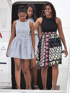 Michelle Obama and Daughters Sasha and Malia Land in Milan in Stylish Dresses