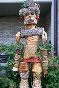 Unique Scarecrow Ideas | like how this is all made out of baskets.