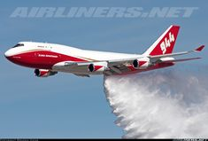 Global SuperTanker Services Boeing 747-446(BCF) N744ST cn 25308 Colorado Springs Airport May 5, 2016 Photo by: Braden Hicks This Boeing 747 Supertanker demonstrating a water drop for the people of Colorado Springs. KCOS will be the new base for this aerial firefighting aircraft.